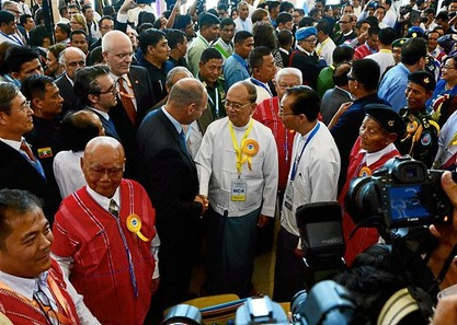 Myanmar President Thein Sein (C) attends the signing ceremony of the Nationwide Ceasefire Agreement (NCA) at the Myanmar International Convention Center (MICC II) in Naypyidaw on October 15, 2015. Myanmar on October 15 signed a ceasefire with eight ethnic minority armies in a step towards ending decades of civil war, a move weakened by the refusal of several other rebel groups to join the deal.  AFP PHOTO