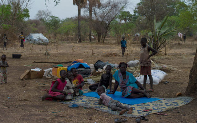 PALORINYA, MOYO DISTRICT - FEBRUARY 25: Refugee families from South Sudan sit on a plot of land allocated to them at a settlement on February 25, 2017 in Palorinya, Uganda. The continued flow of refugees from South Sudan, is putting pressure on the many humanitarian partners, and their capacity to cope with the crisis. The United Nations have said that more than 1.5 million asylum seekers have taken refuge in Uganda, since civil war erupted in South Sudan in December 2013, with 100,00 entering in 2017 so far. Uganda continues to see a flow of between 1000 to 4000 people crossing the border every day. The Bidibidi settlement, one of many across the country, is home to around 274,000 people making it the third largest refugee camp in the world. A famine has just been declared in South Sudan which is likely to lead to an increased flow of people seeking help into the North of the country. People fleeing recent clashes on the border of the Democratic Republic of Congo and Uganda between the M23 rebel group and the Uganda People's Defence Force (UPDF), has also led to a number of refugees entering into the South West of Uganda, though the numbers are unclear.  (Photo by Dan Kitwood/Getty Images)